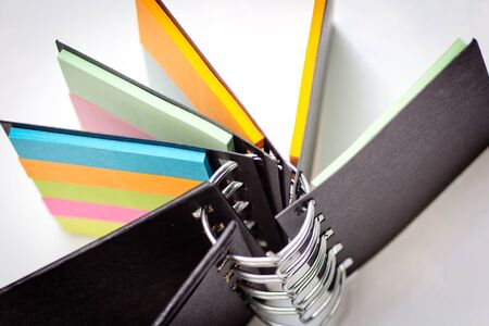 spreaded: A standing spreaded coloured notebook Stock Photo