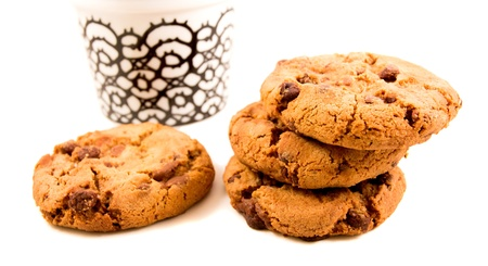 Some cookies lying beside a cup of coffee