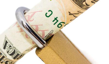 locked up: A padlock holding 10 dollar  locked up isolated on white background