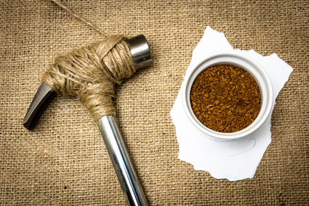 A hammer stopped from destroying a pot full of coffee