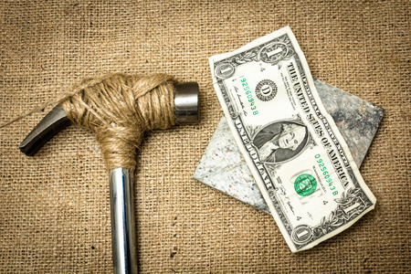 A hammer stopped from destroying money