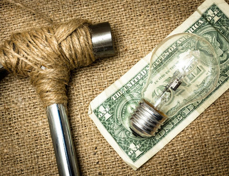 stopped: A hammer stopped from destroying the dollar with a lightbulb