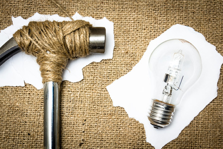 stopped: A hammer stopped from destroying a lightbulb