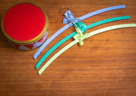 Three colourful vintage hangers on wooden teak Stock Photo