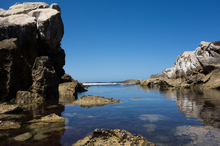 A beautiful coastline with still water in Baleal, Portugal Stock Photo