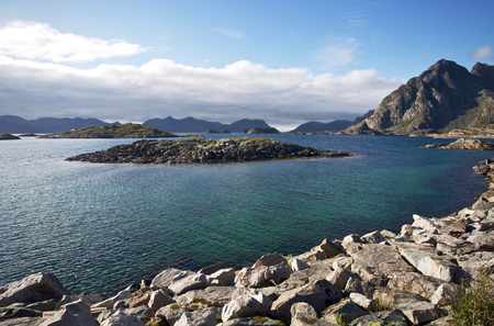 A view out over the sea and some islands near Henningsvaer, Norway Stock Photo