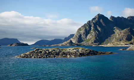 View out over the sea and mountains in Henningsvear, Lofoten, Norway Stock Photo