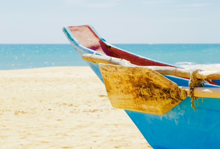 The edge of a colorful wooden boat in Sri Lanka Stock Photo