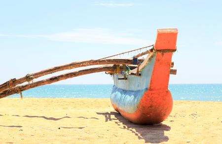 Beautiful wooden fishing boat on the beach on Sri Lanka Stock Photo