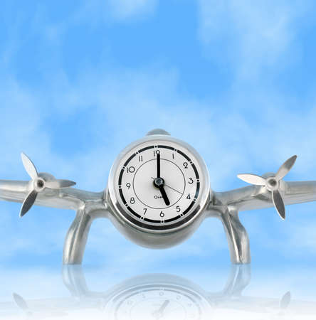 Airplane Desk Clock against Blue Sky with reflection; Concept: Time Flies; Clipping Path Stock Photo
