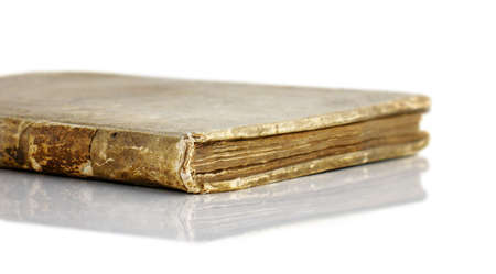 Very old handmade book with leather cover; isolated with reflection