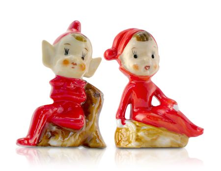 Vintage Christmas Elf Porcelain Figurines--very charming boy and girl elves, isolated with reflection