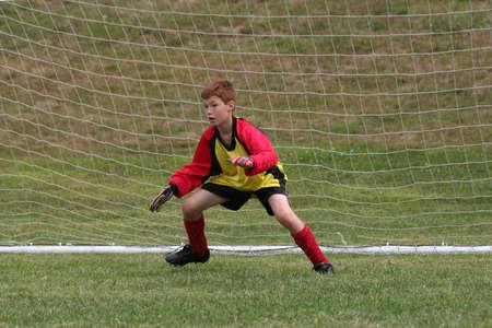 Soccer game: goalkeeper at work  photo