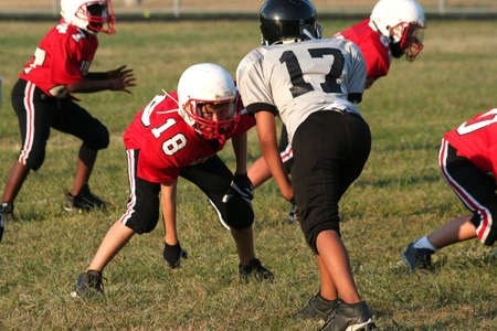 Youth football player in a middle of a game Stock Photo