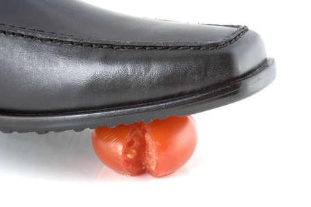crack: Tomato cracked under shoe pressure Stock Photo