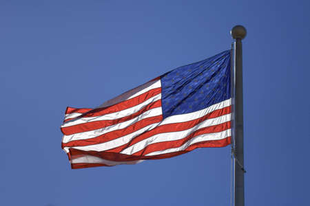 USA flag flutters over blur sky 版權商用圖片