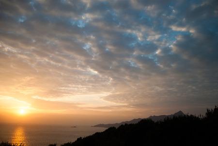 liked: Sunrise and cotton liked clouds, Tai Po, Hong Kong, China Stock Photo