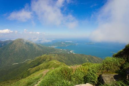 lantau: Peak above shore under blue sky, from Lantau peak, Hong Kong, China