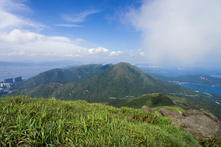 Peak above peaks, under blue sky, from Lantau peak, Hong Kong, China Stock Photo