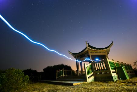 creative force: Funny blue light to a pavilion, Hong Kong, China