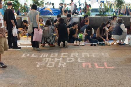 protester: Protester with slogan on Nathan road,  a street blocking demonstration in 2014, Mong Kok, Hong Kong, China Editorial