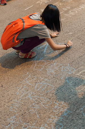 protester: Protester writing on the road,  a street blocking demonstration in 2014, Mong Kok, Hong Kong, China