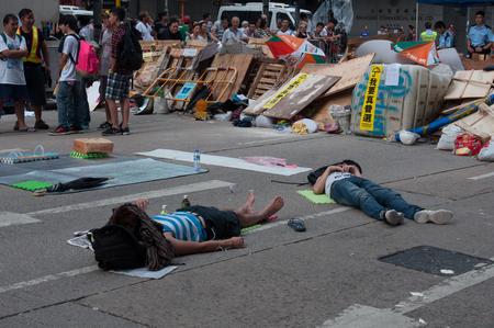 protester: Sleeping protester, a street blocking demonstration in 2014, Mong Kok, Hong Kong, China Editorial