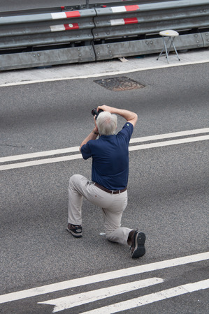 suffrage: Westerner taking photo, a street blocking demonstration in 2014, Admiralty, Hong Kong, China