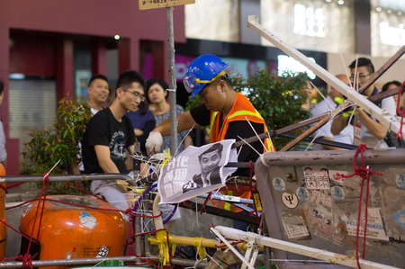 protester: Protester reinforce the blocking on Nathan road, a street blocking demonstration in 2014, Mong Kok, Hong Kong, China