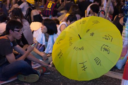 protester: Protester with umbrella on Nathan road, a street blocking demonstration in 2014, Mong Kok, Hong Kong, China