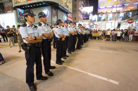 suffrage: Police queue, a street blocking demonstration in 2014, Mong Kok, Hong Kong, China Editorial