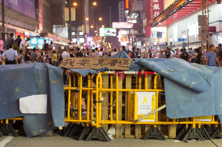 occupy: Barrier and poster on Nathan road, a street blocking demonstration in 2014, Mong Kok, Hong Kong, China