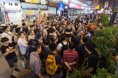 occupy: Onlookers, a street blocking demonstration in 2014, Mong Kok, Hong Kong, China