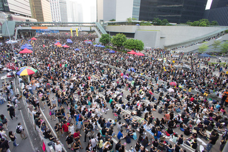 protester: Protester sitting on Connaught road, a street blocking demonstration in 2014, Admiralty, Hong Kong, China