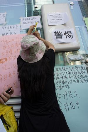 suffrage: A women writing poster, a street blocking demonstration in 2014, Mong Kok, Hong Kong, China