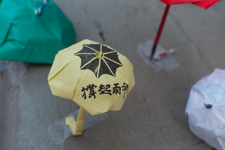 suffrage: Origami yellow umbrella decoration,  a street blocking demonstration in 2014, Admiralty, Hong Kong, China
