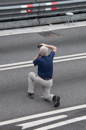 westerner: Westerner taking photo, a street blocking demonstration in 2014, Admiralty, Hong Kong, China