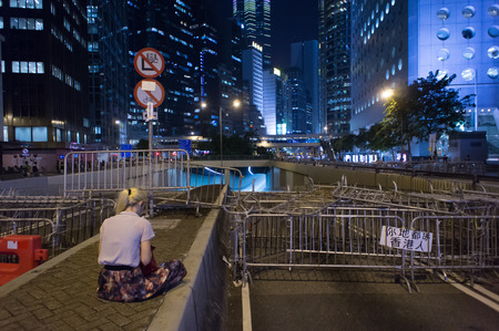 westerner: A Westerner girl reading in blocked area, a street blocking demonstration in 2014, Admiralty, Hong Kong, China
