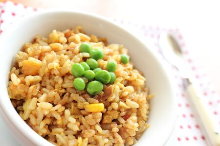 Fried rice curry flavor with green peas Stock Photo