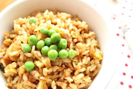 Fried rice curry flavor with green peas photo