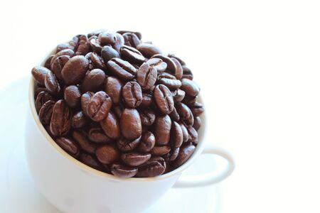 caffiene: coffee beans in coffee cup