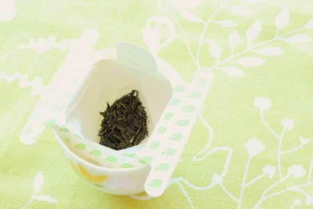 tea filter: Green tea leaf in disposable tea filter