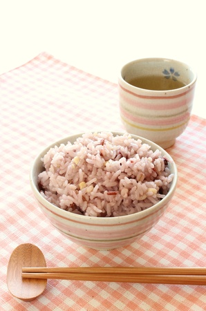 red cooked: Mixed rice in japanese rice bowl with green tea Stock Photo