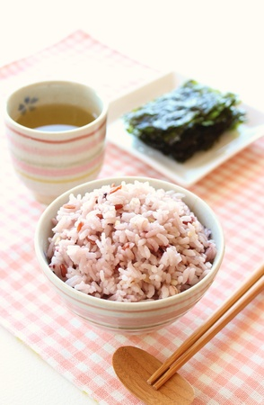 Mixed rice in japanese rice bowl with green tea and roasted seaweed