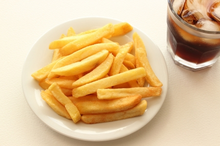 Fried Potatoes on plate and glass of cola photo