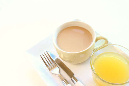 Cup of tea and orange juice Stock Photo