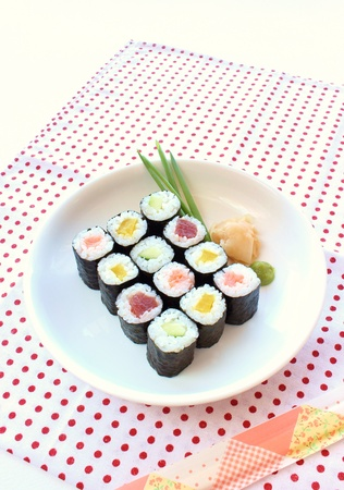 Hosomaki sushi  tuna, smoked salmon, cucumber and vegetables inside Stock Photo