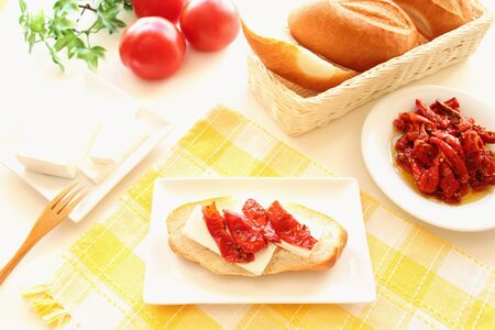 Dried tomatoes and feta cheese open sandwich brunch Stock Photo