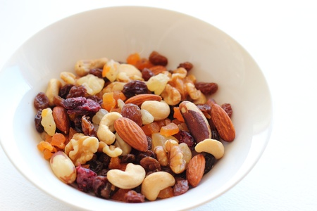 Healthy snack, nuts and dried fruits Stock Photo
