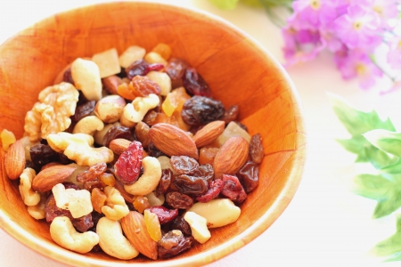 Healthy snack, nuts and dried fruits Stockfoto